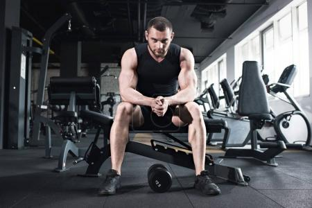 Photo for Young caucasian sportsman sitting at gym looking at camera - Royalty Free Image
