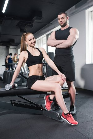 Young sporty caucasian couple at gym
