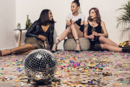 girls drinking champagne with disco ball