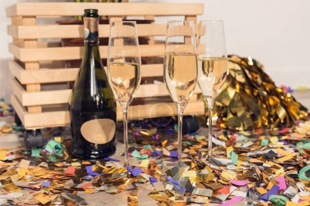 champagne with confetti and wooden box