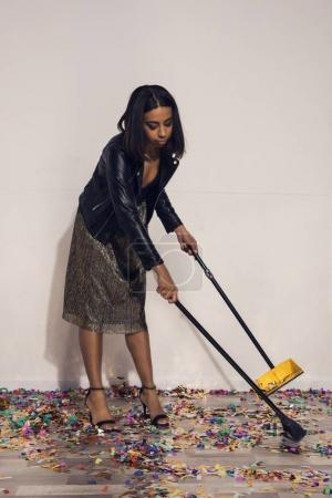 african american girl tidying up confetti