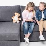 Постер, плакат: Happy kids watching tv