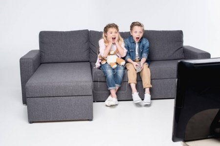 scared children watching tv