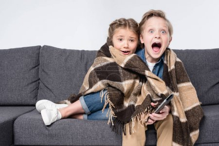 scared children watching tv