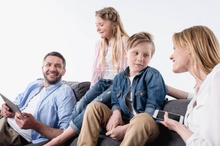 caucasian family with digital devices sitting