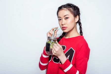 Girl drinking cold beverage