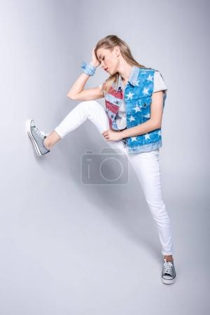 Girl in patriotic denim vest