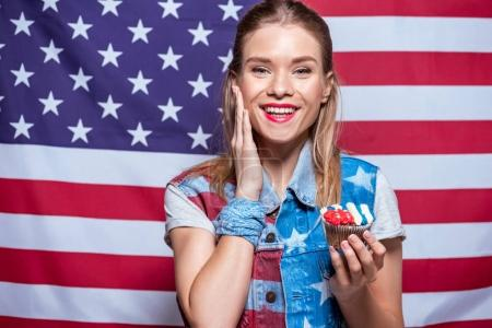 woman with cupcake decorated with American flag