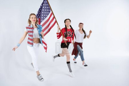 multiethnic women walking with american flag
