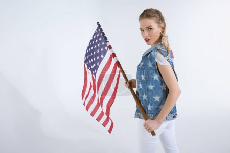 Caucasian girl waving USA flag