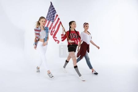 multiethnic girls walking with american flag