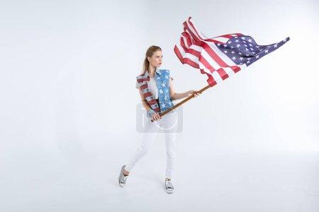 Young woman waving USA flag