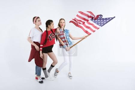 girls posing with american flag