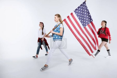 women walking with American flag