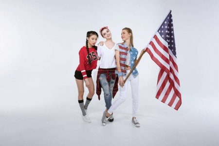 women standing with American flag