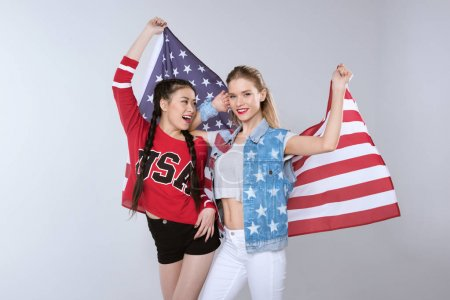 Girls standing and holding flag of USA