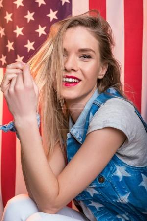 woman posing in front of USA flag