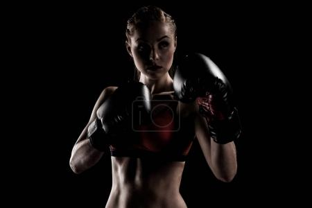 sportswoman exercising in boxing gloves