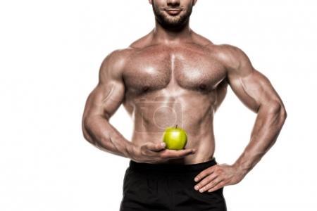 Muscular sportsman holding apple 4