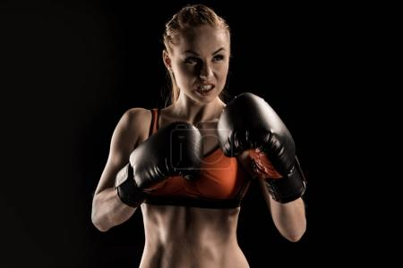 Sportswoman in boxing gloves
