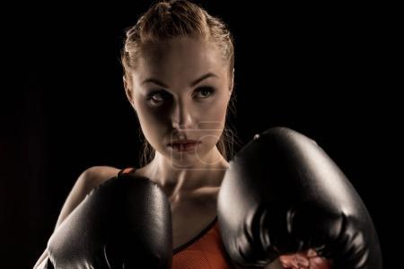 Sportswoman in boxing gloves
