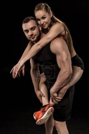 sportive man holding woman