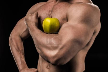 Shirtless man with apple