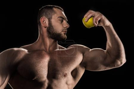 shirtless athlete holding apple
