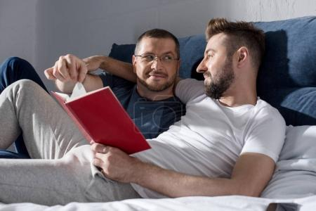 Homosexual couple reading book