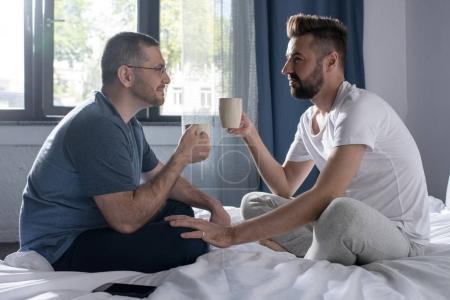 Homosexual couple drinking coffee