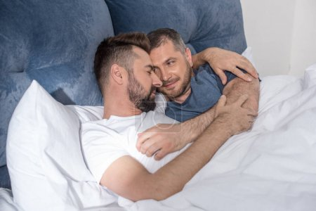 Homosexual couple in bed