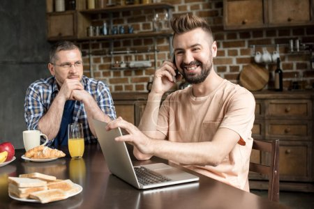 Man using laptop during breakfast