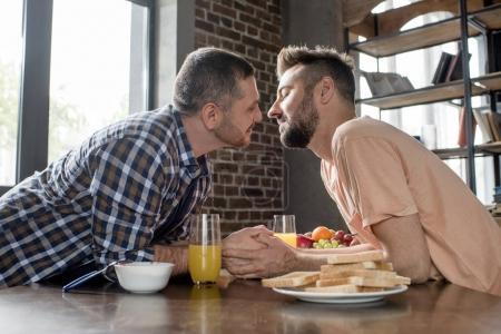 Gay couple having breakfast