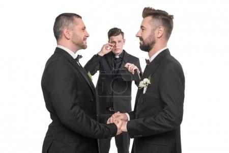 Photo for Homosexual couple pronouncing vows and holding hands at wedding ceremony - Royalty Free Image