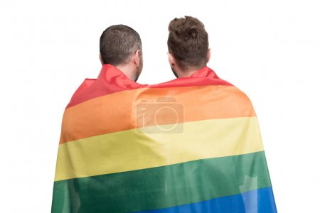 Photo for Back view of homosexual couple standing together covered by lgbt flag isolated on white - Royalty Free Image