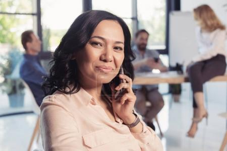 mature businesswoman talking on smartphone