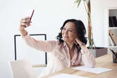 mature asian businesswoman taking selfie
