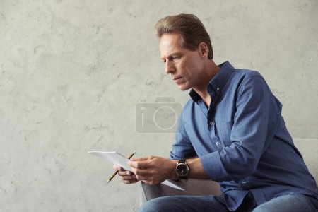 Pensive middle aged artist