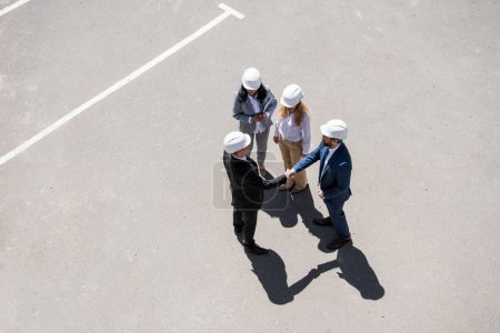 Photo for Aerial view of group of architects in formal wear talking at meeting outdoors - Royalty Free Image