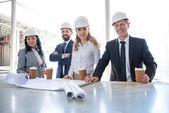 team of multiethnic contractors in formal wear