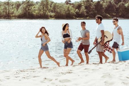 friends spending time on beach