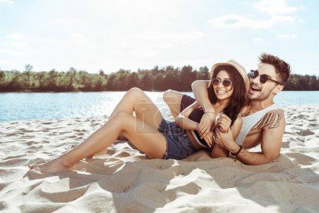 couple resting on beach