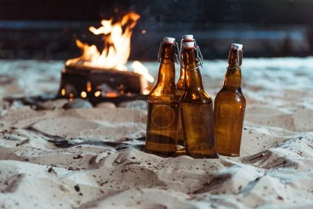 bottles of beer on sandy beach