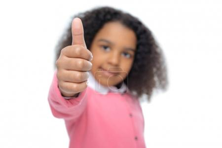 african american girl showing thumb up