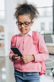 Cute little girl with smartphone