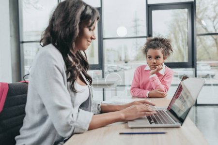 businesswoman working with daughter