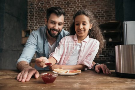 Father and daughter eating toasts 3