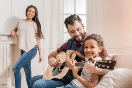 Family playing guitar