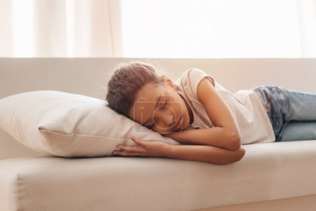 Photo for Adorable little african american girl sleeping on sofa at home - Royalty Free Image