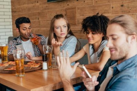 Multiethnic people sitting in cafe